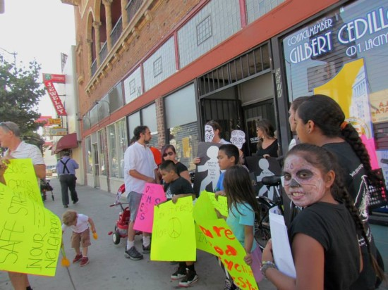 Protesters gather outside councilman Gil Cedillo's office in Highland Park. (NELA Art Gallery Night)