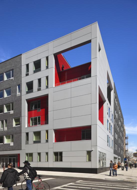 A raw aluminum rain screen envelops the building's communal areas. (Courtesy Alexander Gorlin Architects)