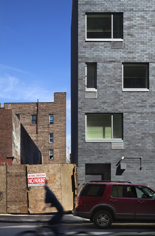 The Brook's residential wings are wrapped in dark grey brick. (Courtesy Alexander Gorlin Architects)