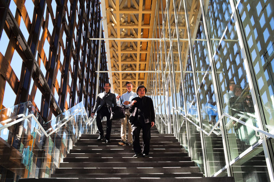 Shigeru Ban and key members of his design and project team (Dean Maltz and Zachary Moreland) descend the museum's grand stair. (Courtesy AAM/David X Prutting)