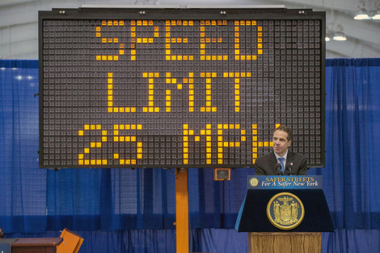 Cuomo signing the legislation. (Courtesy New York Governor's Office)