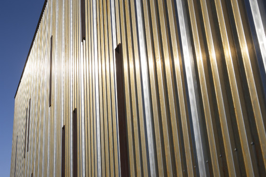 The remaining sides of the building are clad in corrugated weathering steel. (Timmerman Photography)