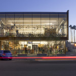 The structural glass wall on the north facade advertises the shop's contents. (Timmerman Photography)
