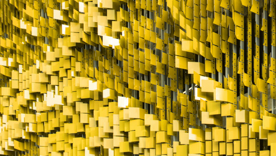 The lightweight facade comprises 7,000 bent aluminum panels attached to a steel structural frame. (Serge Hoeltschi)
