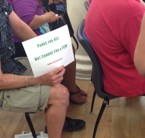 Signs at the meeting. (Henry Melcher / AN)