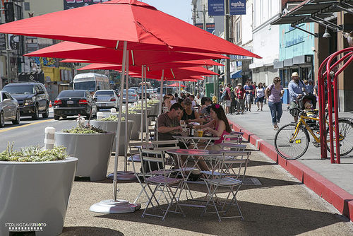 Tables, chairs, planters and umbrellas on Broadway (Sterling Davis/ Curbed LA Flickr Pool)