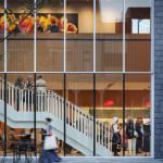 A custom curtain wall on the north facade draws light into Nelson Cultural Center. (Paul Crosby Photography)