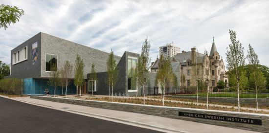 HGA's Nelson Cultural Center, clad in slate shingles and art glass, complements the historic Turnblad Mansion. (Paul Crosby Photography)