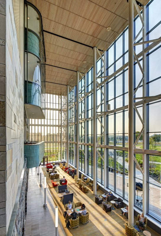 A 40-foot-tall curtain wall opens up the north facade to create an indoor/outdoor living room. (Courtesy SHW Group, now Stantec)