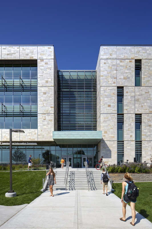 The size of the envelope's punched windows indicate the programming within, while faux copper accents mark points of entry. (Courtesy SHW Group, now Stantec)