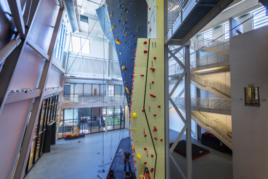 The sunlit tower features a multi-story climbing and training wall. (©Dana Sohm)