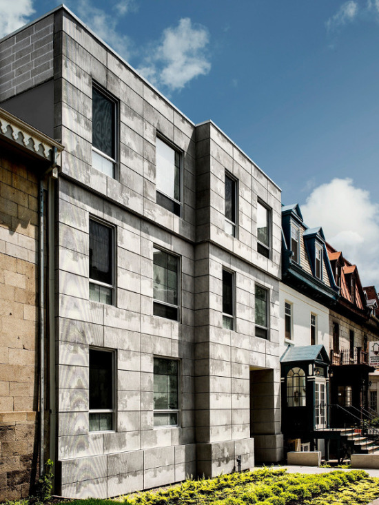 The facade of KANVA's Edison Residence combines references to the site's history with an exploration of new technology. (Marc Cramer/v2com)