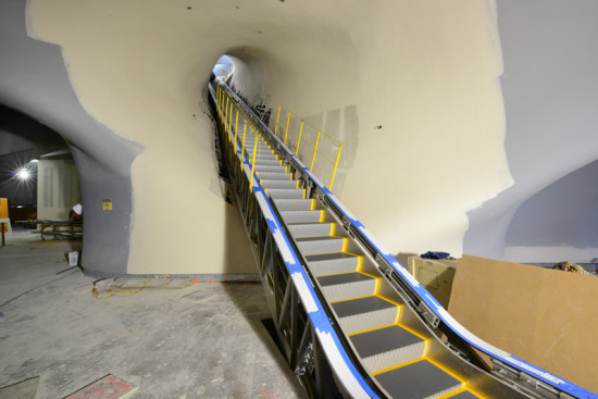 105-foot escalator that goes directly to the third floor gallery (Nelson and Sixta)