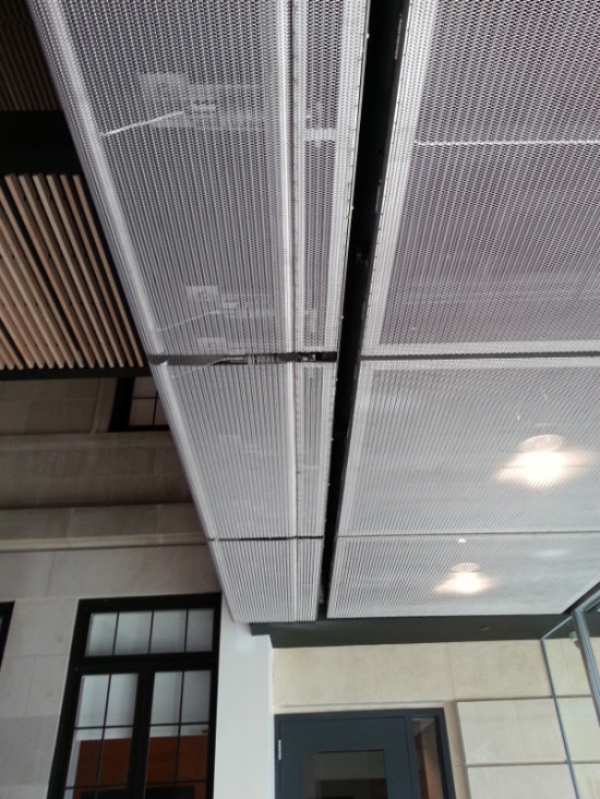 Cambridge Architectural designed rigid mesh panels for the lobby ceiling. (Courtesy Cambridge Architectural)