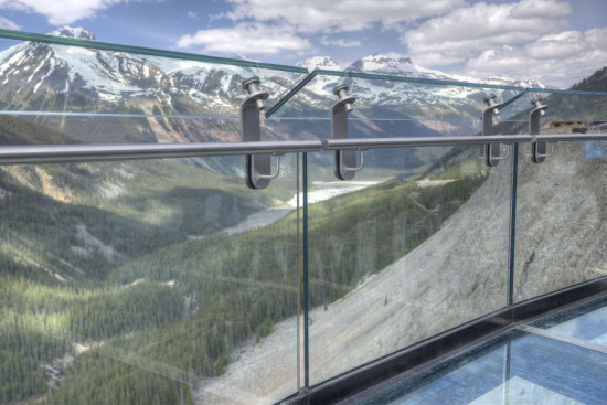 A structural glass floor and railing magnify the sense of exposure. (Courtesy Sturgess Architecture)