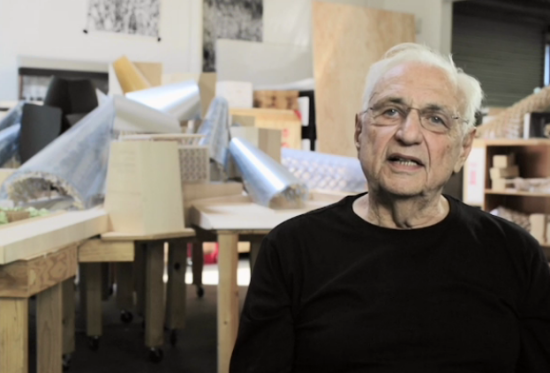 Gehry and his Guggenheim model. (Screengrab via NYTimes)