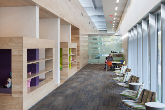 The new reading room surrounds the library's core services. (Courtesy Gould Evans)