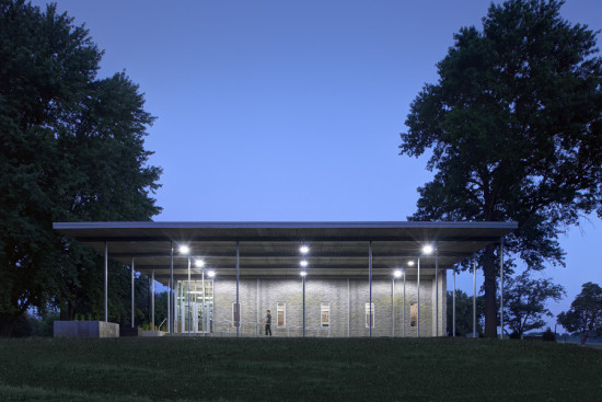 The shelter area is built from textured precast concrete and storm-safe windows. (Cameron Campbell, Integrated Studio)
