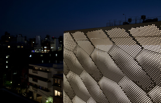 Jaklitsch/Gardner Architects' flagship Tokyo store for Marc Jacobs features a lantern-like, non-occupiable top story sheathed in punched aluminum. (Liao Yusheng)