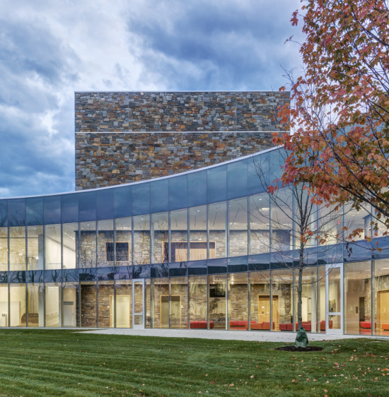 The curving glass curtain wall embraces a new green space. (Anton Grassl/Esto)