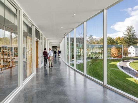 """The building's various """"neighborhoods"""" all open onto a glass corridor facing the green. (Anton Grassl/Esto)"""