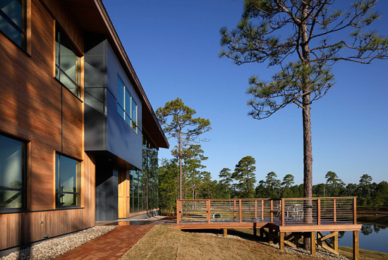 Aluminum panels at stairways and entries break up the long wood facade. (Courtesy LS3P)