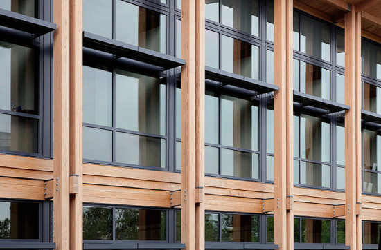 Fixed sunshades integrated directly into the curtain wall reduce thermal gain. (Courtesy LS3P)