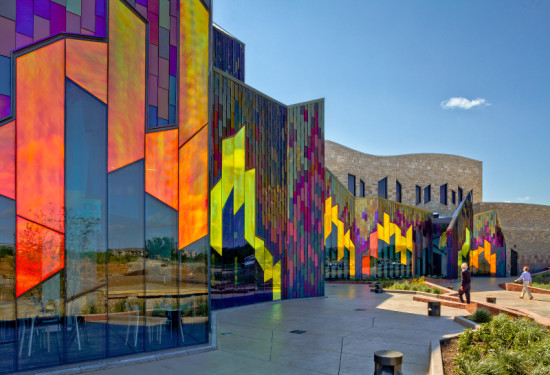 VernerJohnson's Museum at Prairiefire features a multi-colored envelope in dichroic glass, iridescent steel, and Kansas limestone. (Sam Fentress)