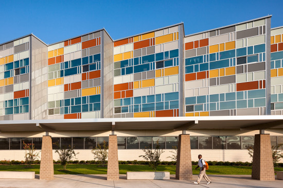 Multicolored glass curtain walls embody the quilt metaphor at the heart of Muñoz & Company's Billy Dade Middle School. (Courtesy Muñoz & Company)