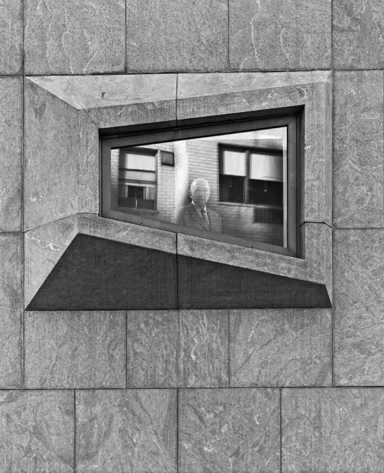 Marcel Breuer peers from the window of the former Whitney Museum in 1967. (Ezra Stoller / Esto)