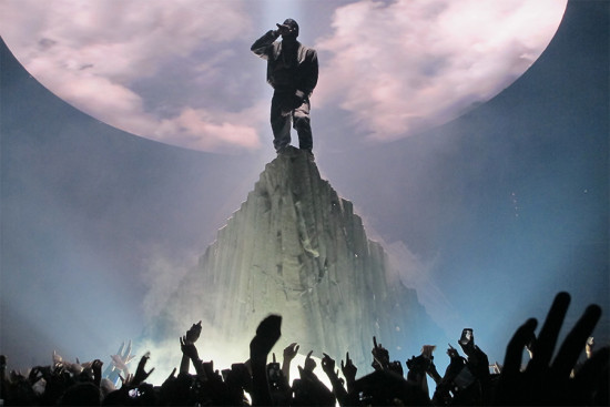 Kanye atop a mountain on his Yeezus tour. (Peter Hutchins / Flickr)