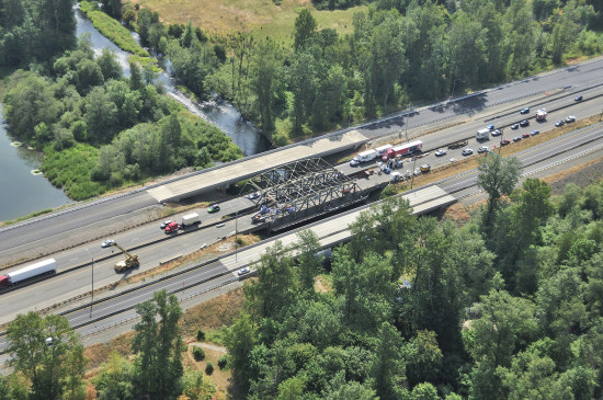 The overhead steel truss on a pair of I-5 bridges spanning the Skookumchuck River in Washington State is one piece of infrastructure getting overdue repairs. Hits from overheight loads will be fixed and the overhead clearance will be straightened out to and even height across all lanes. (Washington State Department of Transportation)