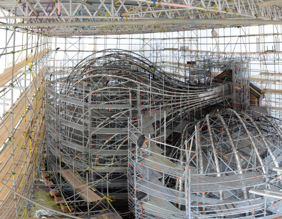 Steel frames with temporary cross bracing were erected within a large custom scaffolding system. (Heatherwick studio)