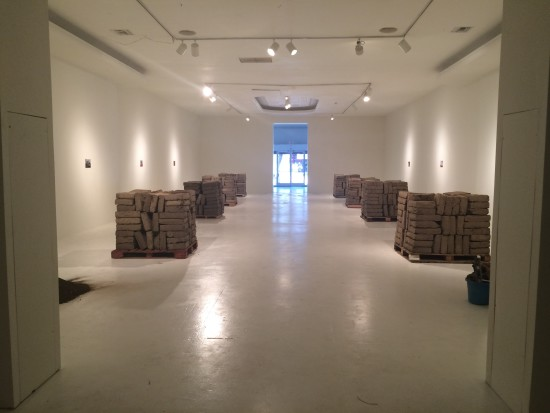 Adobe bricks in neat piles. (Courtesy of LACE (Los Angeles Contemporary Exhibitions))