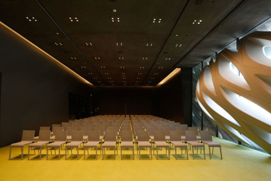 """The """"oculus"""" leans into a second floor lecture hall, intruding beyond the exterior enclosure to the interior. (Elizabeth Daniels)"""