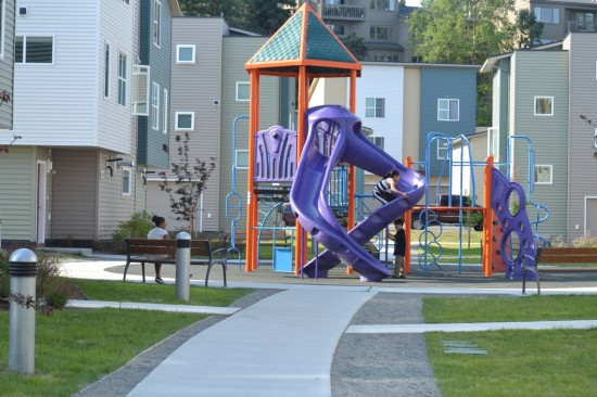 "Cook Inlet Housing Authority: ""The heart of our Loussac Place development features a play area for young residents and seating for parents."" Courtesy Artplace America"
