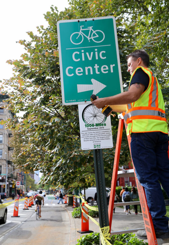 Marking the 1,000th mile of bike lane on Clinton Street (Courtesy NYC DOT)