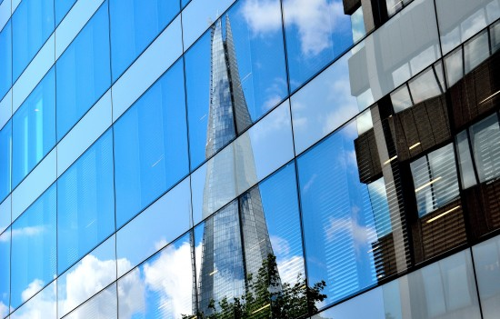 The Shard, by Renzo Piano, seen in the reflection of another glass skyscraper. ( Courtesy Tez Goodyer / Flickr )