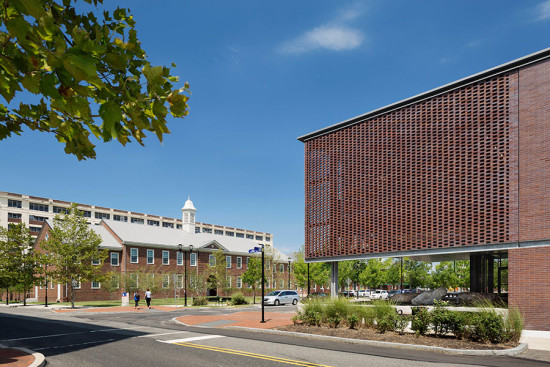The brick facade pays homage to a Georgian-style building across thee street which the architects renovated to function as a living laboratory for advanced energy retrofit technology. (image courtesy Michael Moran/OTTO)