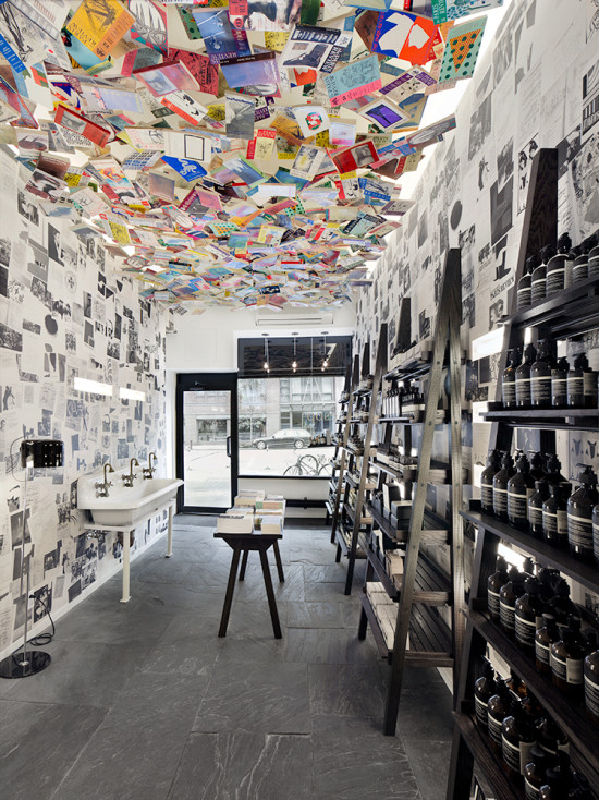 Aesop Chelsea was created in collaboration with The Paris Review with a ceiling installation of around 1,000 original editions of The Paris Review hung on threads.