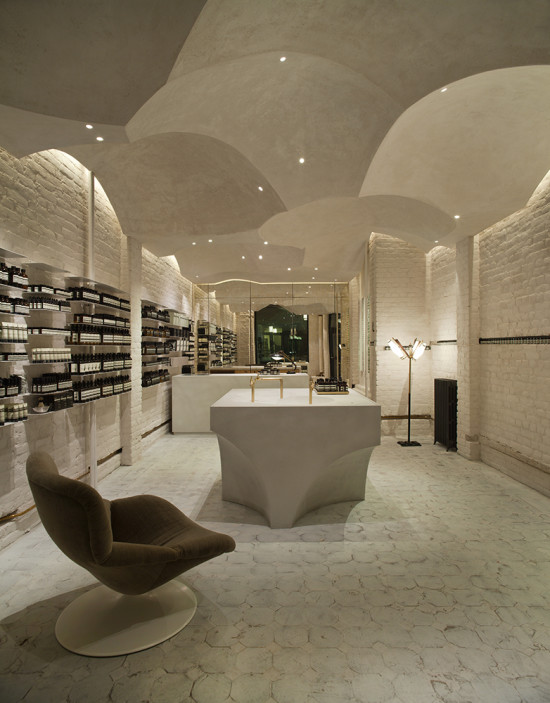 The ceiling in Aesop Prisensgate, Oslo, is composed of ten domes fabricated from fiber-reinforced concrete with a matte gypsum plaster finish.