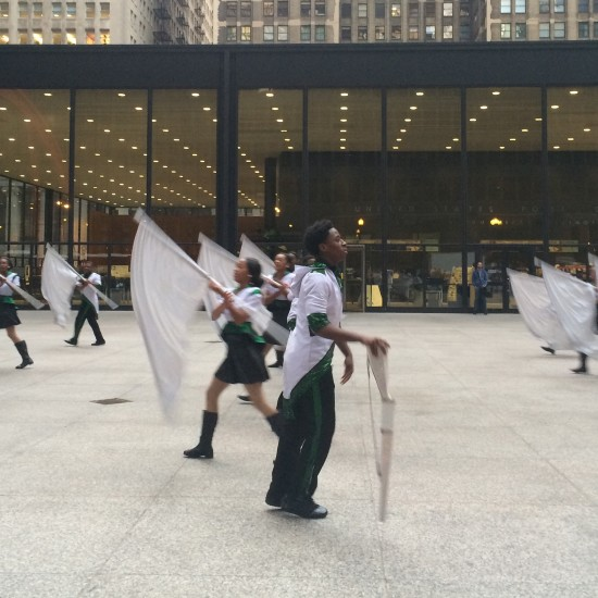 The South Shore Drill Team with Mies' post office behind. (Mimi Zeiger/AN)