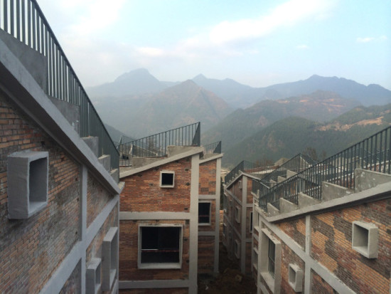 Stepped roofs designed to be planted with gardens on top of Jintai Village houses.