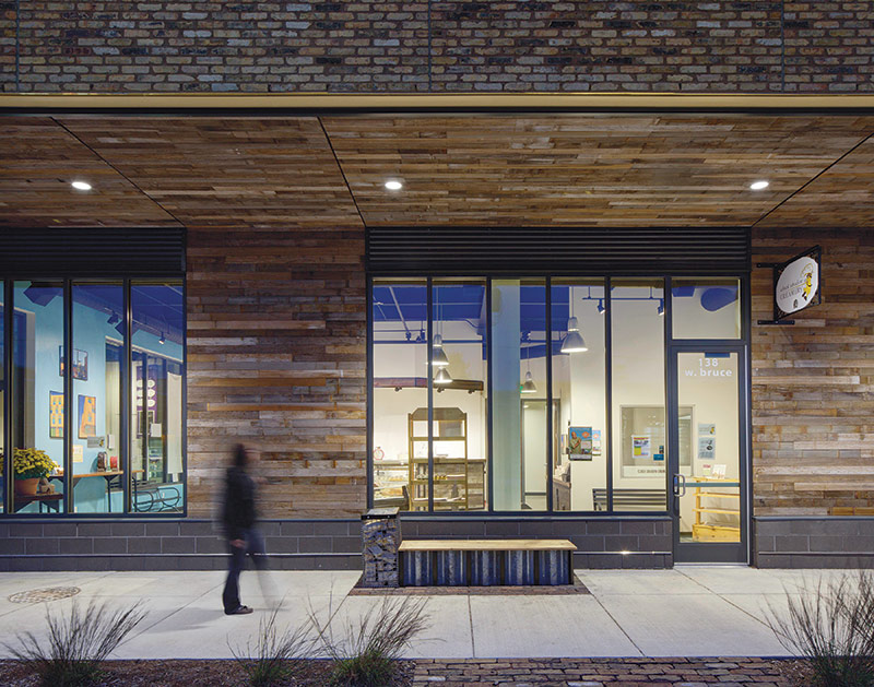 The building uses reclaimed pickle barrel wood on its facade. - Space Time Continuum - Archpaper.com