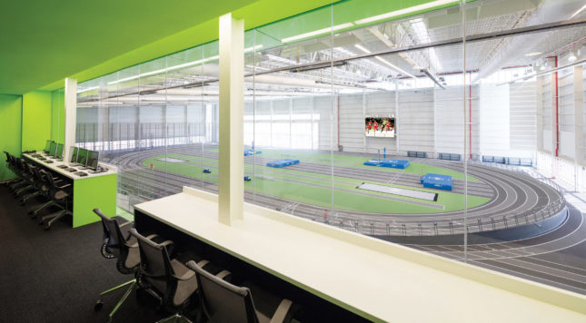 The Sage and Coombe–designed Ocean Breeze Indoor Athletic Facility features a 200-meter hydraulically banked track that converts to a flat track for practices. (Courtesy V+B; NYC Parks)