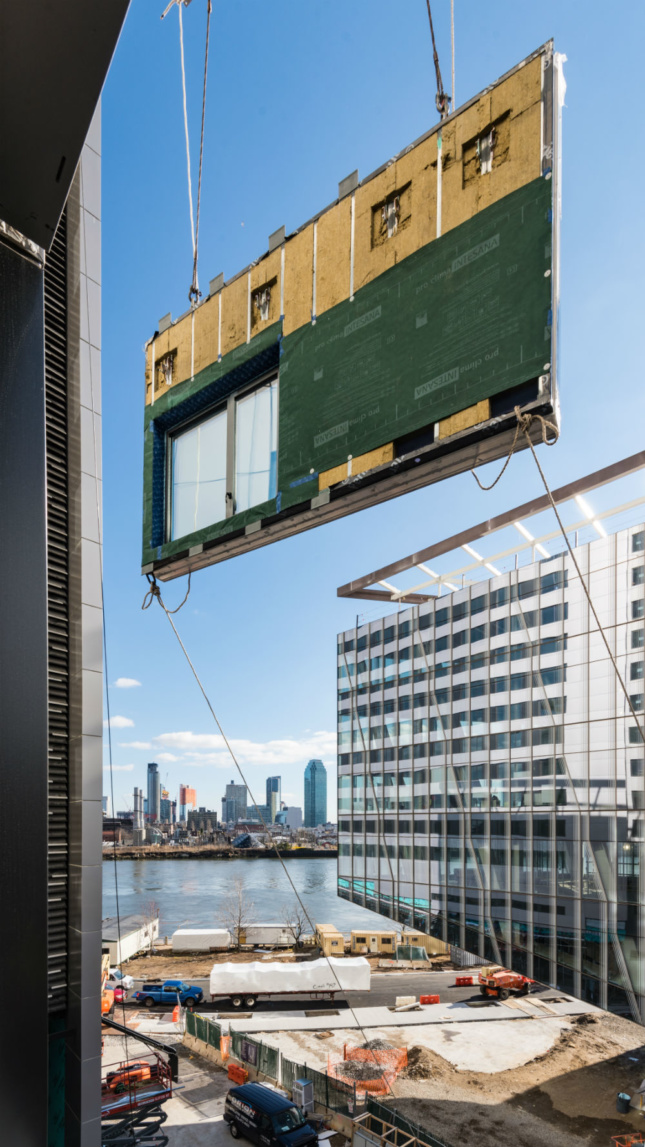 One of the prefabricated panels being installed onto the facade. (Courtesy Handel Architects)