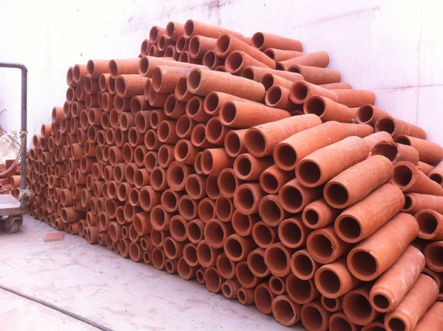 Photo of a stack of terra-cotta tubes