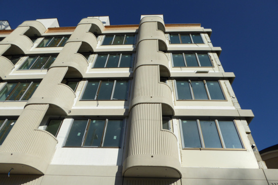 A close up looking up the under-construction facade of Holstrasse 100.