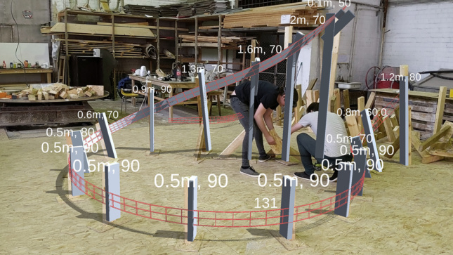 People working overlaid with 3D renders of a curving line.