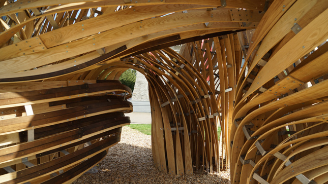 A curved timber pavilion